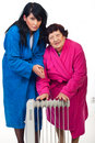 Cold shivering  women with radiator heat Stock Images