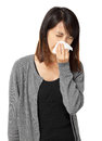 Cold sneezing asian woman isolated on white background Stock Images