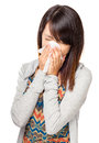 Cold sneezing asian woman isolated on white background Royalty Free Stock Photo