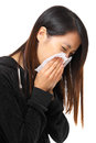 Cold sneezing asian woman with white background Stock Photography