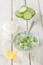 Cold soup with cucumber parsley dill parsley and sour cream Stock Photo