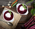 Cold soup fresh beet with cream, sugar, hot pepper, vintage spoon, napkin on a wooden background Royalty Free Stock Photo