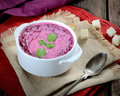 Cold soup fresh beet with cream, sugar, vintage spoon, napkin on a wooden background Royalty Free Stock Photo
