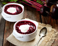 Cold soup fresh beet with cream, vintage spoon, napkin on a wooden background Royalty Free Stock Photo