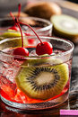 Cold summer cocktail drink with cherry and kiwi red Stock Photos