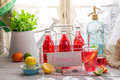 Cold summer drink in bottle on old wooden table Stock Images