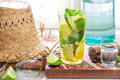 Cold summer drink in glass on old wooden table Royalty Free Stock Images