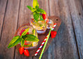 Cold summer drink with mint, strawberry and lemon Royalty Free Stock Photo