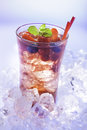 Cold summer drink refreshment with berries mint and soda on ice cubes Royalty Free Stock Photography