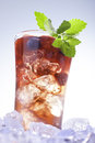 Cold summer drink refreshment with berries mint and soda on ice cubes Stock Images
