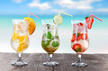 Cold summer drinks on sunny beach Stock Photography