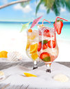 Cold summer drinks on sunny beach Stock Images