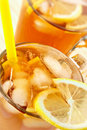 Cold tea with cubes of an ice and a lemon Royalty Free Stock Photo