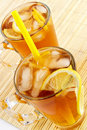 Cold tea with cubes of an ice and a lemon Royalty Free Stock Photography