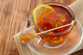 Cold tea with ice cube, lemon and sugar Royalty Free Stock Photo