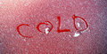 Cold text on a frozen red surface picture of word Stock Photo