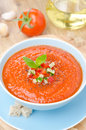Cold tomato soup gazpacho with basil in a bowl on top of the ver vertical view Royalty Free Stock Photo