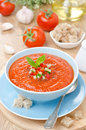 Cold tomato soup gazpacho with basil in a bowl vertical blue Royalty Free Stock Image