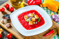 Cold tomato soup in a white square-shaped plate, top view. Royalty Free Stock Photo
