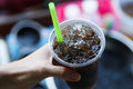 Cold water with ice in a glass iced grass jelly dessert Royalty Free Stock Images