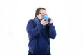 Cold weather, the wind. The guy in the scarf drinking coffee. Royalty Free Stock Photo