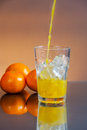 Cold wet orange juice with ice cubes Royalty Free Stock Image
