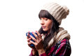 A cold woman drinking hot drink Royalty Free Stock Photos
