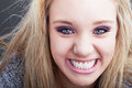 Colgate smile a close up portrait of a pretty caucasian girl with blond hair smiling broadly showing off sparkly white teeth Royalty Free Stock Photos