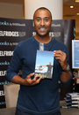 Colin jackson jacksons signs copies of his book my sporting icons to mark the london olympics at selfridges london picture by Royalty Free Stock Photography