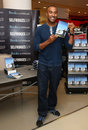 Colin jackson jacksons signs copies of his book my sporting icons to mark the london olympics at selfridges london picture by Stock Photos