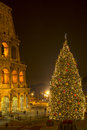 The coliseum and the christmas tree in rome italy night long exposure Royalty Free Stock Image