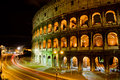 Coliseum by night rome italy the colosseum was built in the s ad and was the largest amphitheatre built during the roman empire Stock Photography
