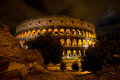 Coliseum by night rome italy the colosseum was built in the s ad and was the largest amphitheatre built during the roman empire Royalty Free Stock Photo
