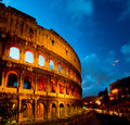 Coliseum by night with traffic rome italy the flavian amphitheater in Stock Photo