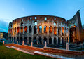 Coliseum by night with traffic rome italy the flavian amphitheater in Royalty Free Stock Images