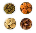 Collage of different dried fruits. Raisins, dates, dried apricots, fig isolated on white background Royalty Free Stock Photo