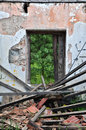 Collapsed roof abandoned house chipped wall and open door with view to nature scene interior Stock Images