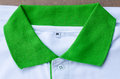 Collar mans polo shirts green and white colors Stock Photo