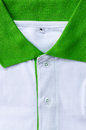 Collar mans polo shirts green and white colors Royalty Free Stock Images