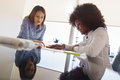 Colleagues Architect Women Talking Plans And Housing Project Royalty Free Stock Photo