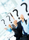 Colleagues holding question mark on boards Royalty Free Stock Photos