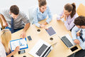 Colleagues working in office, high angle Royalty Free Stock Photo