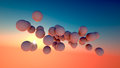 A collection of balls floating drifting high in the atmosphere Stock Image
