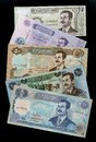 Collection of banknotes iraqi dinars portrait saddam hussein isolated on a blek background Royalty Free Stock Photo