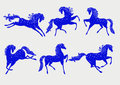 Collection of blue horses stylized a symbol Stock Photos