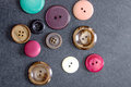 Collection of buttons old on table from above Royalty Free Stock Images