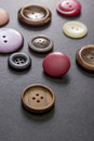 Collection of buttons old on table close up Stock Photo