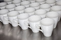 Collection of coffee mugs in office Royalty Free Stock Images