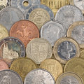 Collection of coins forming a background like euro swiss franc pound and rubel Royalty Free Stock Photos
