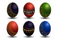 Collection colored easter eggs with gold patterns coloured on a white background Stock Photo